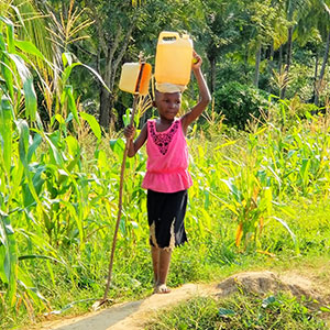 Girl carrying water on head