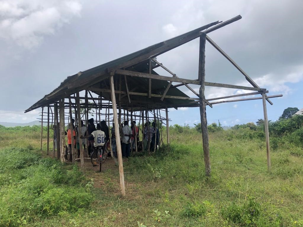 Villagers of Lutsanga in a unfinished building