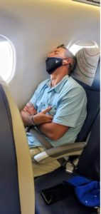Jason Sucher asleep on the plane