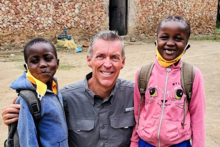 Jason smiling with two kids