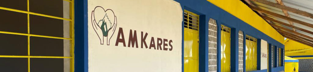 Side of School with AM Kares sign